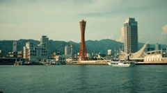 View of Kobe bay with arriving ship and Port Tower. 4K resolution retro look. Stock Footage