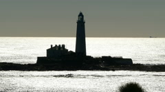 Lighthouse in silhouette. Stock Footage