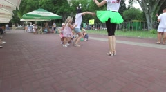 Nikolaev, Ukraine - Children playing in an area with an woman Stock Footage