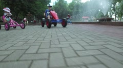 Nikolaev, Ukraine-Children ride bicycles in park Stock Footage