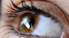 Closeup brown eye of a girl Stock Footage
