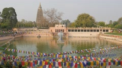 Pond with buddha statue,BodhGaya,Mahabodhi Temple Complex,India Stock Footage