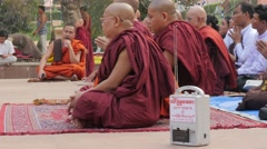 Monks praying with wireless speaker,BodhGaya,Mahabodhi Temple Complex,India Stock Footage