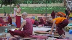 Tibetan monks prostrate praying,BodhGaya,Mahabodhi Temple Complex,India Stock Footage