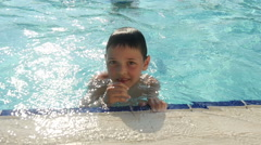 Cheerful boy plunge in the pool , slow motion. Stock Footage