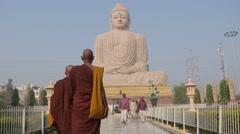 Monk and pilgrims at Great Buddha statue,BodhGaya,India Stock Footage
