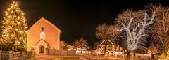 Winter night lights in an Austrian village Stock Photos