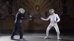 Slow motion Two fencers in fierce duel Stock Footage