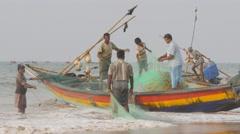 Fishermen loading net on boat,Puri,India Stock Footage