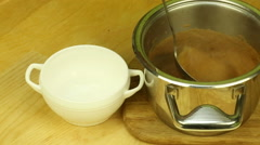 Transfusion of soup from the pot in a bowl Stock Footage