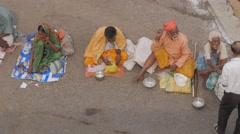 Beggars begiing near temple,Puri,India Stock Footage