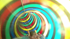 Family having joy, fun sliding down water slide tube in aqua park Stock Footage