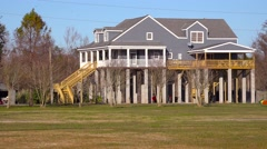 Houses in Louisiana are built on stilts to prevent flooding from broken levies. Stock Footage