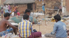 Men reparing fishing net with wire roll,Puri,India Stock Footage