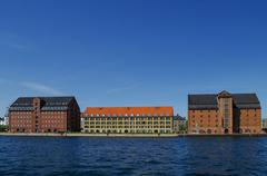 Copenhagen cityscape of canal and houses on embankment in sunny spring day. D Stock Photos