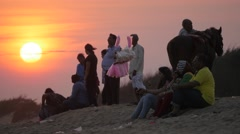Indian tourists going home  on beach at sunset,Konark,India Stock Footage