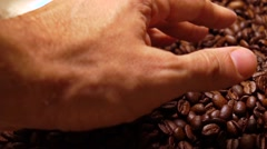 Man hand scooping roasted coffee beans, super slow motion shot Stock Footage