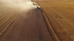 Harvesters are moving on field. Stock Footage