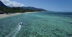 4K Drone Aerial Shot Tracking Boat over Clear Blue Water in Mauritius Stock Footage