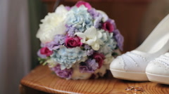 Wedding shoes rings bouquet of flowers Arkistovideo