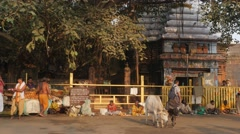 Busy street scene in front of Lingaraja temple,Bhubaneswar,India Stock Footage
