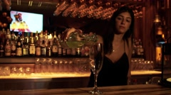 Woman Pour a glass of wine Stock Footage