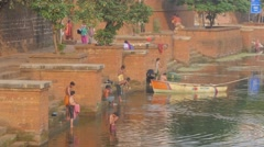 Men washing in sacred Bindu Sagar lake,Bhubaneswar,India Stock Footage