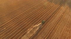 Aerial view of moving harvester. Stock Footage