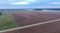 Misty fields in morning birds eye view Stock Footage