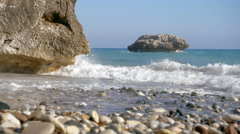 Wave breaks on the Aphrodite cape.  Prores 4K. Stock Footage