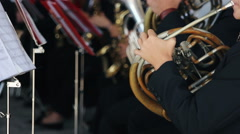 Young guys play on wind instrument in orchestra Stock Footage