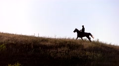 Horse rider is moving fast Stock Footage