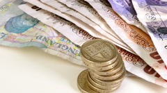 Sterling (pounds) notes and coins. Stock Footage