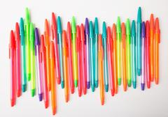 Ballpoint pens of different colors on a white background Stock Photos