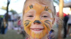 Body art painting smile face of little cute child girl happy childhood portrait Stock Footage