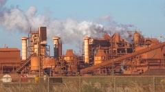 An aluminum refinery emits smoke clouds. Stock Footage