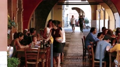 """Tables of a traditional """"osteria"""" along the Sottoriva street Stock Footage"""
