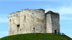 A young boy climbing down the steps of Clifford's Tower, York, England. Stock Footage