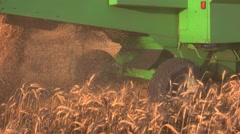 Back view of moving combine. Stock Footage