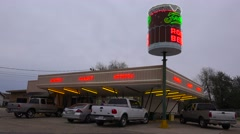 A drive up diner with a giant root beer mug sign rotating. Stock Footage