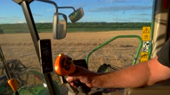 Man's hand on harvester controls. Stock Footage