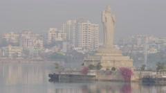 Giant buddha statue on island in Hussain Sagar lake,Hyderabad,India Stock Footage