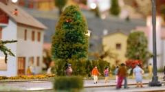 Model tram arrives then two trains pass by on a diorama Stock Footage