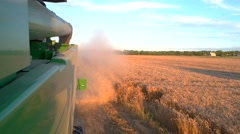 Trail of dust behind combine. Stock Footage