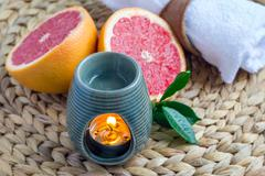 Aroma lamp with grapefruit essential oil, spa background, horizontal Stock Photos