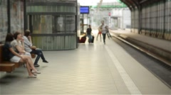 Young family of two spouses, son and daughter, running to catch the train before Stock Footage