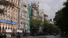 Street with traffic and historical buildings,Mumbai,India Stock Footage