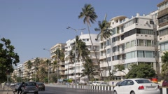 White buildings along Back bay with palm trees,Mumbai,India Stock Footage