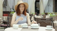 Young pretty woman drinking herb tea Stock Footage