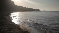 A man walks along the seashore Stock Footage